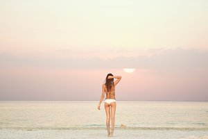 beautiful sexual woman against the sea and sunset
