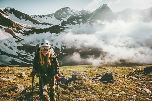 Woman traveler hiking mountains