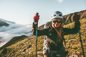 Woman hiking in mountains Travel