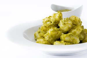 Gnocchi with pesto sauce in plate