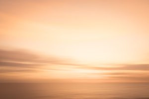Abstract golden sunset sky and ocean