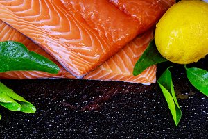 Raw salmon fish fillet and lemon