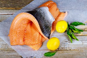 Fresh raw salmon fillet and lemon