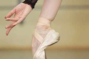 Leg and arm of a ballerina. Pointe
