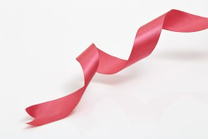 Red curly ribbon isolated on white
