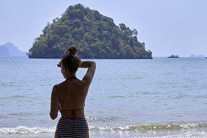 Young woman standing in bikini look