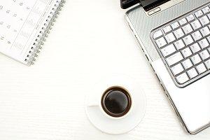 laptop, coffee and calendar