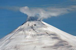 Snowy cone active volcano on sunny
