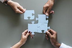 Business teamwork cooperation jigsaw