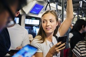 Woman using a smartphone in subway