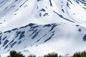 Snowcapped cone of volcano