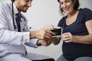 Pregnant woman meeting with doctor