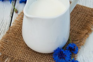 Jar of milk and cornflowers