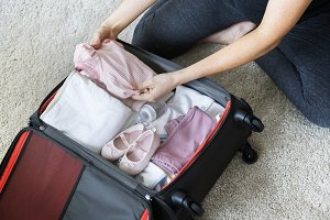 Pregnant woman packing baby stuff