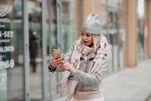 A girl making selfie near shops