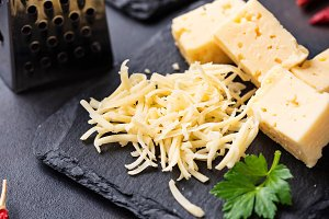 Grated cheese on slate board