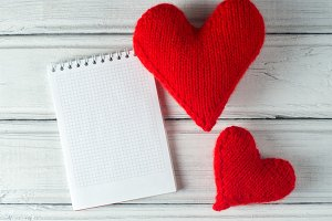 two red hearts and a Notepad with co
