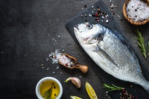 Dorado and ingredients for cooking