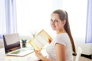 Pregnant woman working at home.
