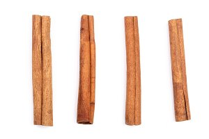 Cinnamon sticks isolated on white background. Top view