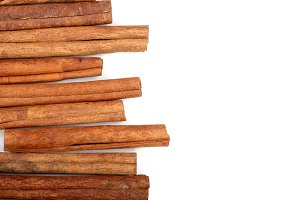 Cinnamon sticks isolated on white background with copy space for your text. Top view