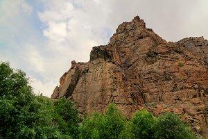 Buddha image on rock over Kar Gah ri