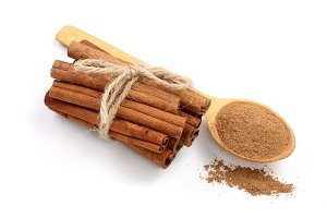 Cinnamon sticks bunch with powder isolated on white background. Top view