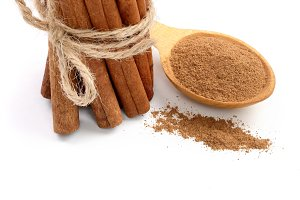 Cinnamon sticks bunch with powder isolated on white background with copy space for your text. Top view