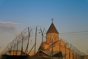 Armenian church behind barbed wire,