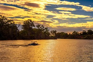 Sunset over Murray river  with a boat in Mildura, Australia