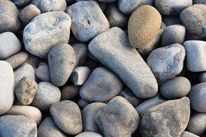 Sea pebbles or grey stones