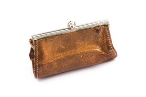 Old coin purse isolated on white