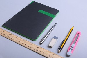 office supplies and gadgets on desk.
