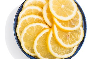 Sliced lemon circles into pieces.