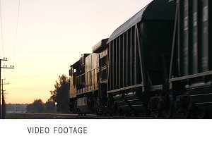 Freight train passing by countryside