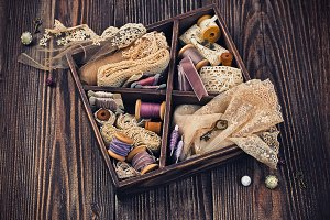 Wooden box with ribbons and lace