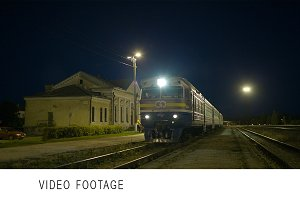 Train coming to rural station.