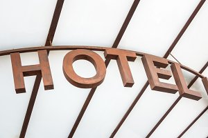 Hotel sign over glass canopy access