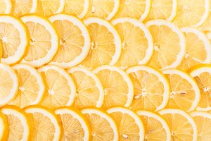 Slices of fresh yellow lemon.