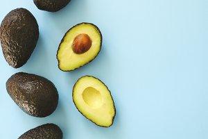Fresh avocado on blue background