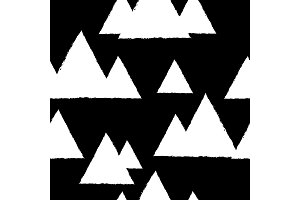 Seamless pattern with geometric snowy mountains. White triangles and black background.