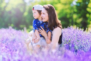 Happy woman, boy, lavender landscape