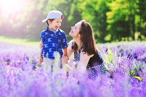 Happy mom & cute son in lavender