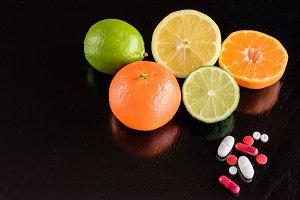 Vitamins in pills or fruit