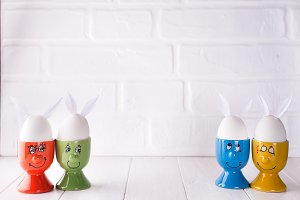 Easter eggs with hare ears in holders