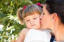 Kissing sad little girl.jpg