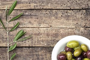 Purple and green olives background