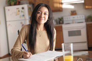 african american teen doing homework