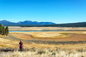 Woman and Valley in Yellowstone Nati