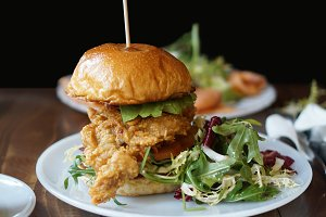 Chicken burger with arugula salad